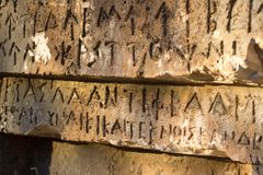 Inscription on old tomb in the Greek language. Characters, symbols. Hieroglyphs Royalty Free Stock Images
