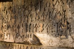Inscription on old tomb in the Greek language. Characters, symbols. Hieroglyphs Royalty Free Stock Image