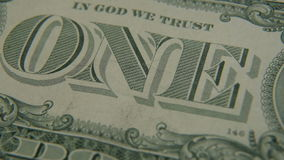 The inscription `ONE` on a one-dollar bill stock footage