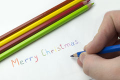 The inscription on the paper, merry Christmas. Stock Photo