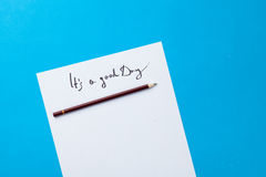 Inscription on a paper and pencil Stock Image