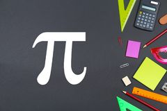 The inscription of PI day and chalk on a blackboard. The inscription of PI day and chalk on a blackboard royalty free stock image