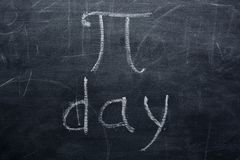 The inscription of PI day on the school Board. а stock image