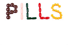 Inscription pills made of medical tablets, health care concept, copy space for text on white Stock Images