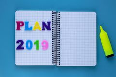 Inscription plan. Copy, empty space. Blank notebook. Education plan. 2019 year. Card for concept of planning. Notebook and pencil royalty free stock image