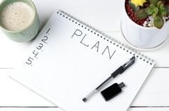 Inscription Plan in notepad, close-up, top view, concept of planning, goal setting royalty free stock photography