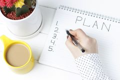 Inscription Plan in notepad, close-up, top view, concept of planning, goal setting.  stock photos