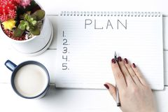 Inscription Plan in notepad, close-up, top view, concept of planning, goal setting.  stock photo