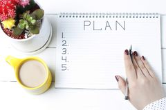 Inscription Plan in notepad, close-up, top view, concept of planning, goal setting.  stock images
