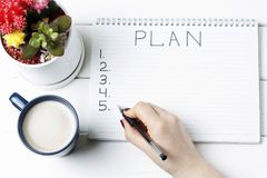 Inscription Plan in notepad, close-up, top view, concept of planning, goal setting.  royalty free stock photography
