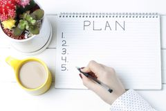 Inscription Plan in notepad, close-up, top view, concept of planning, goal setting.  royalty free stock photos