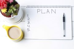 Inscription Plan in notepad, close-up, top view, concept of planning, goal setting.  stock photography