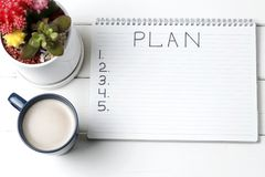 Inscription Plan in notepad, close-up, top view, concept of planning, goal setting.  royalty free stock images