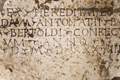Inscription on plaque. Ancient stone plaque with latin inscription stock photography