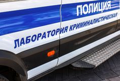 Inscription `Police, Crime lab` on the board of russian police vehicle. Police patrol car stock photo