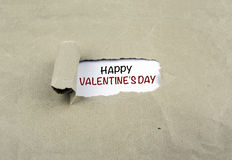 Inscription revealed on old paper - Happy Valentine's Day Royalty Free Stock Photography