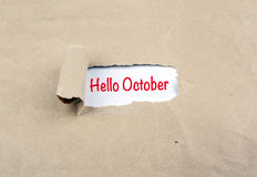 Inscription revealed on old paper - Hello October Royalty Free Stock Photography