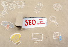 Inscription revealed on old paper - SEO Search Engine Optimizati Royalty Free Stock Photos