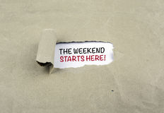 Inscription revealed on old paper - The Weekend Starts Here!. Inscription revealed on old paper - The Weekend Starts Here Royalty Free Stock Images