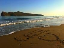 Inscription romantique sur le ` de Crète d'amour du ` I de sable Photographie stock libre de droits