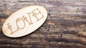 Inscription romantique sur un fond en bois Photo stock