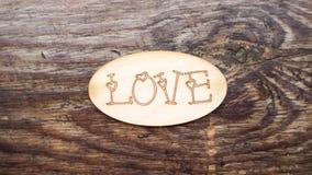 Inscription romantique sur un fond en bois Image libre de droits