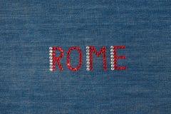 Inscription Rome, inlaid rhinestones on denim. Royalty Free Stock Photography