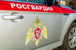 Inscription Rosgvardia and emblem of the troops of the National Guard of the Russian Federation on the board of car Stock Photography