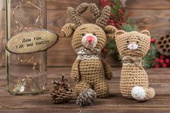 The inscription in Russian `Home is where we are together` Crochet Kraft Toys cat and deer royalty free stock image