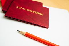 Inscription in Russian Identification. Red certification on white paper with a red pencil Stock Photo