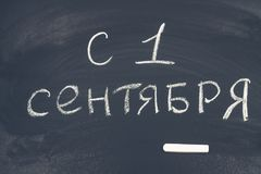 The inscription in Russian is September 1. Chalk on a blackboard. Stock Photos