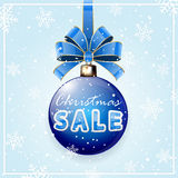 Inscription Sale on blue Christmas ball Royalty Free Stock Photos