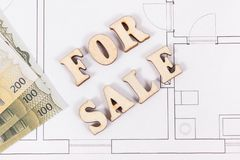 Inscription for sale and currencies euro on electrical drawing, concept of selling and buying house or flat. Inscription for sale and currencies euro on stock photos