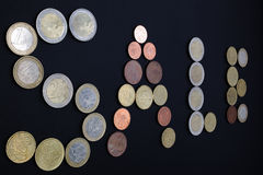 Inscription Sale, laid out coins. Royalty Free Stock Photography