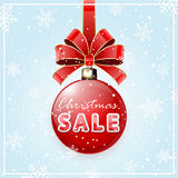 Inscription Sale on red Christmas ball Stock Photo