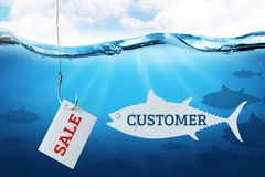 The inscription sale on the sheet as bait for buyers. Fishing hook with fish bait as symbol of deception. royalty free stock photos