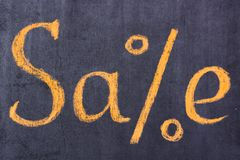 Inscription Sale on a signboard in the shop window stock images