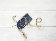 Inscription sale of twine in my hand, the price tag on denim on Stock Photo