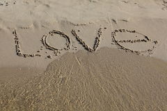 Inscription on sand. Love message written in sand on beach Royalty Free Stock Image