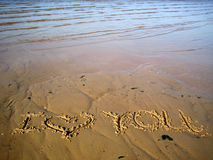 Inscription on sand. About a love Royalty Free Stock Images