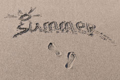 Inscription on sand. Word summer which is written on sea sand Royalty Free Stock Photography