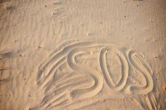 The inscription on the sand beach SOS.  royalty free stock photo