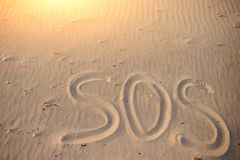 The inscription on the sand beach SOS.  stock image