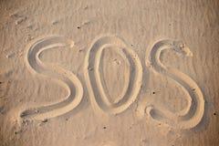 The inscription on the sand beach SOS.  stock image