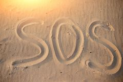 The inscription on the sand beach SOS.  stock photography