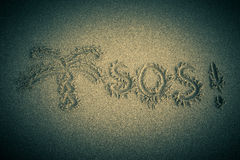 The inscription on the sand beach. SOS Stock Photography