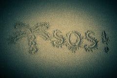 The inscription on the sand beach. SOS stock photography
