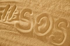 Inscription on the sand beach SOS with hashtag. Space for text. Inscription on the sand beach SOS with hashtag. Copy space for text stock photo