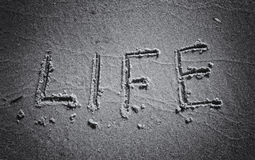 Inscription on the sand black and white life Royalty Free Stock Photos