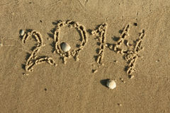 The inscription on the sand 2014 Stock Photos